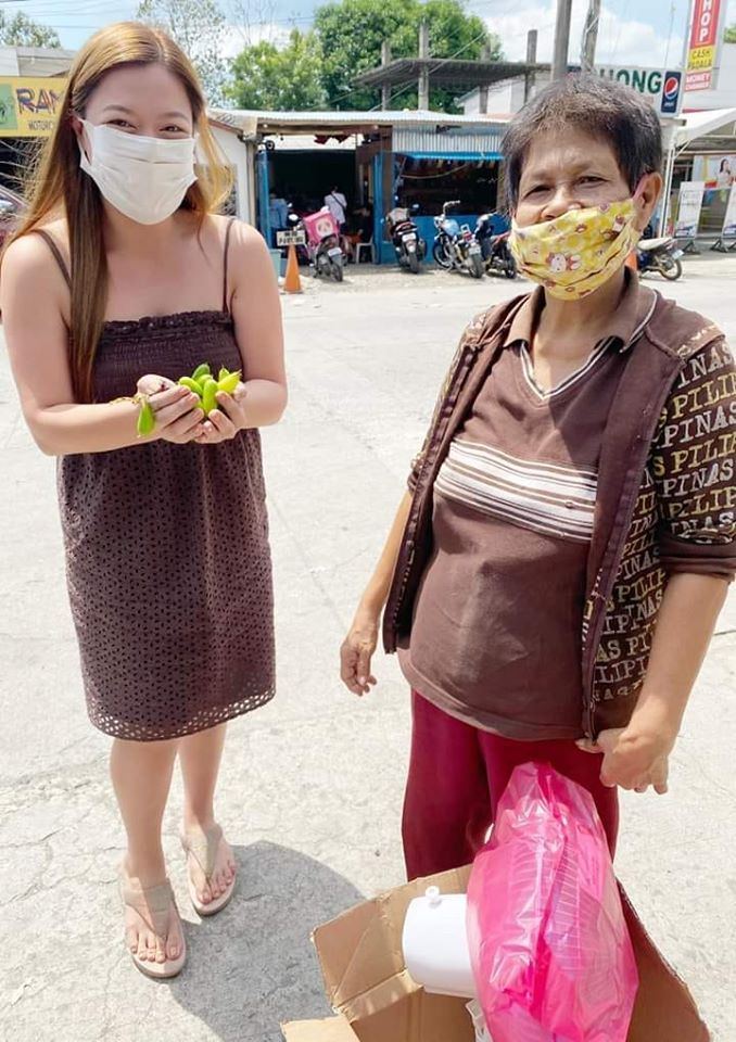 old woman receives new electric fan