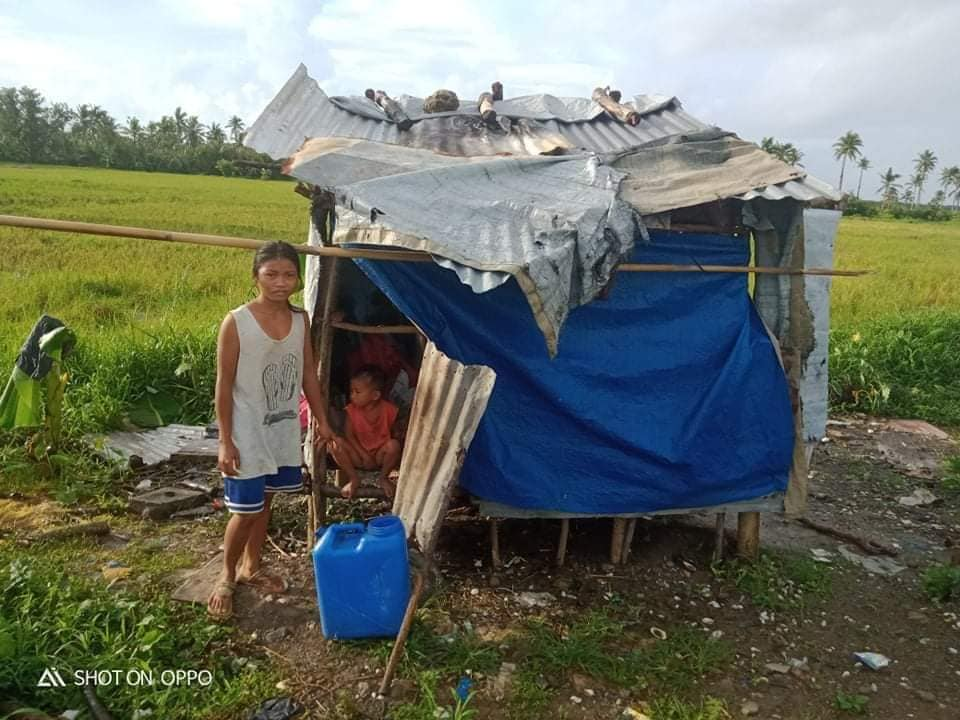 family living in a shack