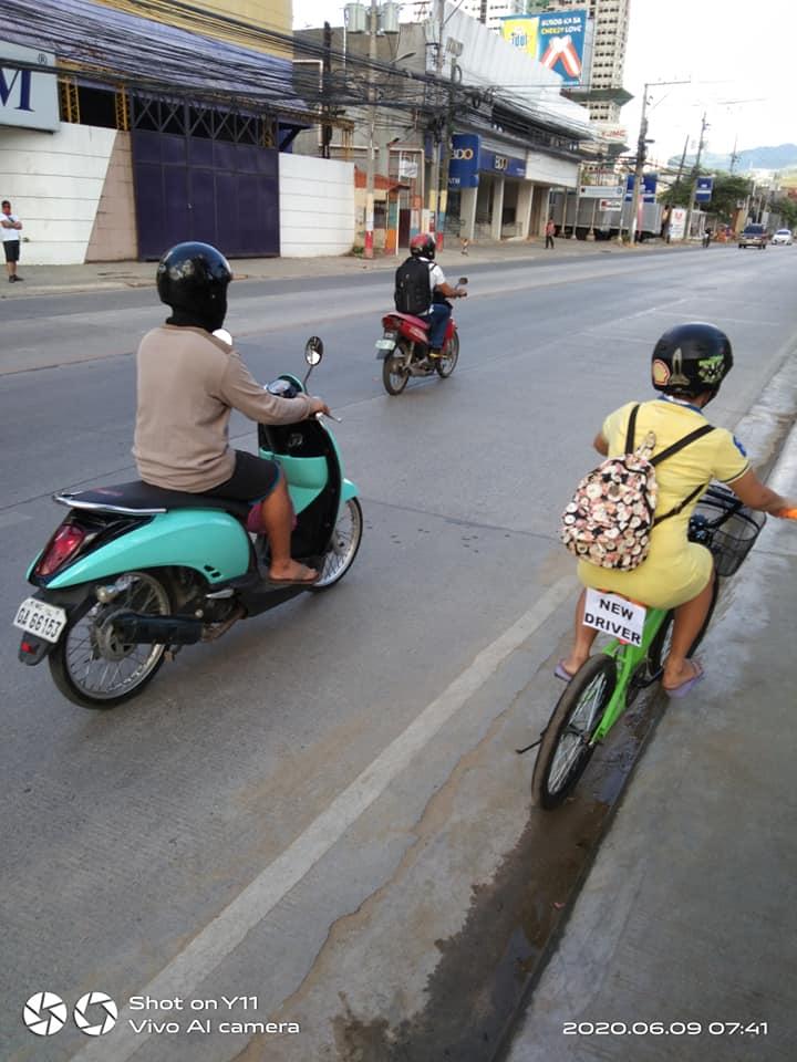 woman struggling on bike