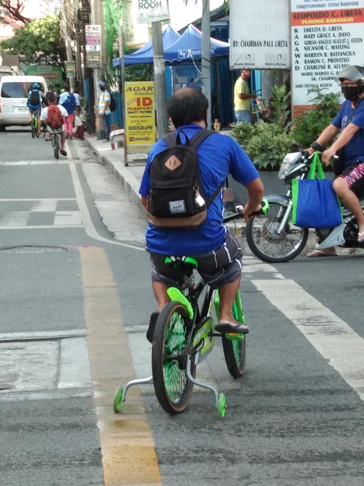 man bikes with training wheels